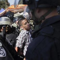 Israeli police detain a Palestinian demonstrator during a protest in Jerusalem, Friday, Sept. 14, 2012 as part of widespread anger across the Muslim world about a film ridiculing Islam's Prophet Muhammad.