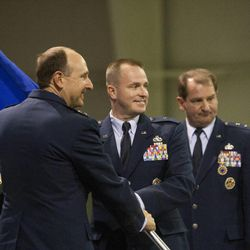 Brig. Gen. Carl Buhler assumes command during a change of command ceremony at Hill Aerospace Museum, Monday, Sept. 8, 2014. Buhler assumed command of the Ogden Air Logistics Complex from Maj. Gen. H. Brent Baker Sr.