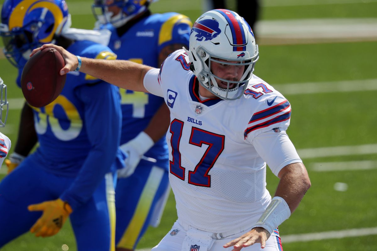 Josh Allen #17 of the Buffalo Bills spikes the ball after a touchdown against the Los Angeles Rams at Bills Stadium on September 27, 2020 in Orchard Park, New York. Bills beat the Rams 35 to 32.