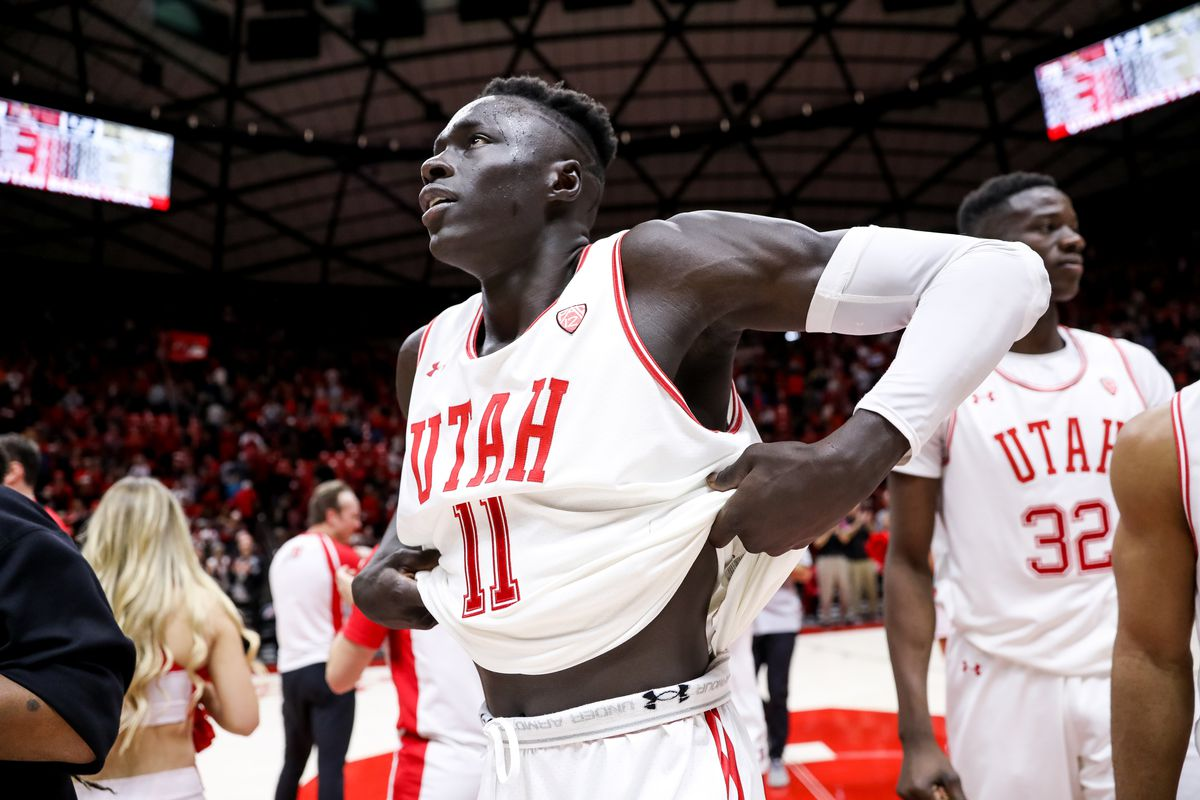 Utah Utes guard Both Gach (11) celebrates after the Utes beat the Colorado Buffaloes 74-72 in overtime at the Huntsman Center in Salt Lake City on Saturday, March 7, 2020.