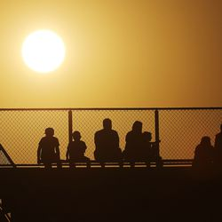 Fans watch Fremont and Skyridge as the sun sets in Lehi on Thursday, Aug. 12, 2021.