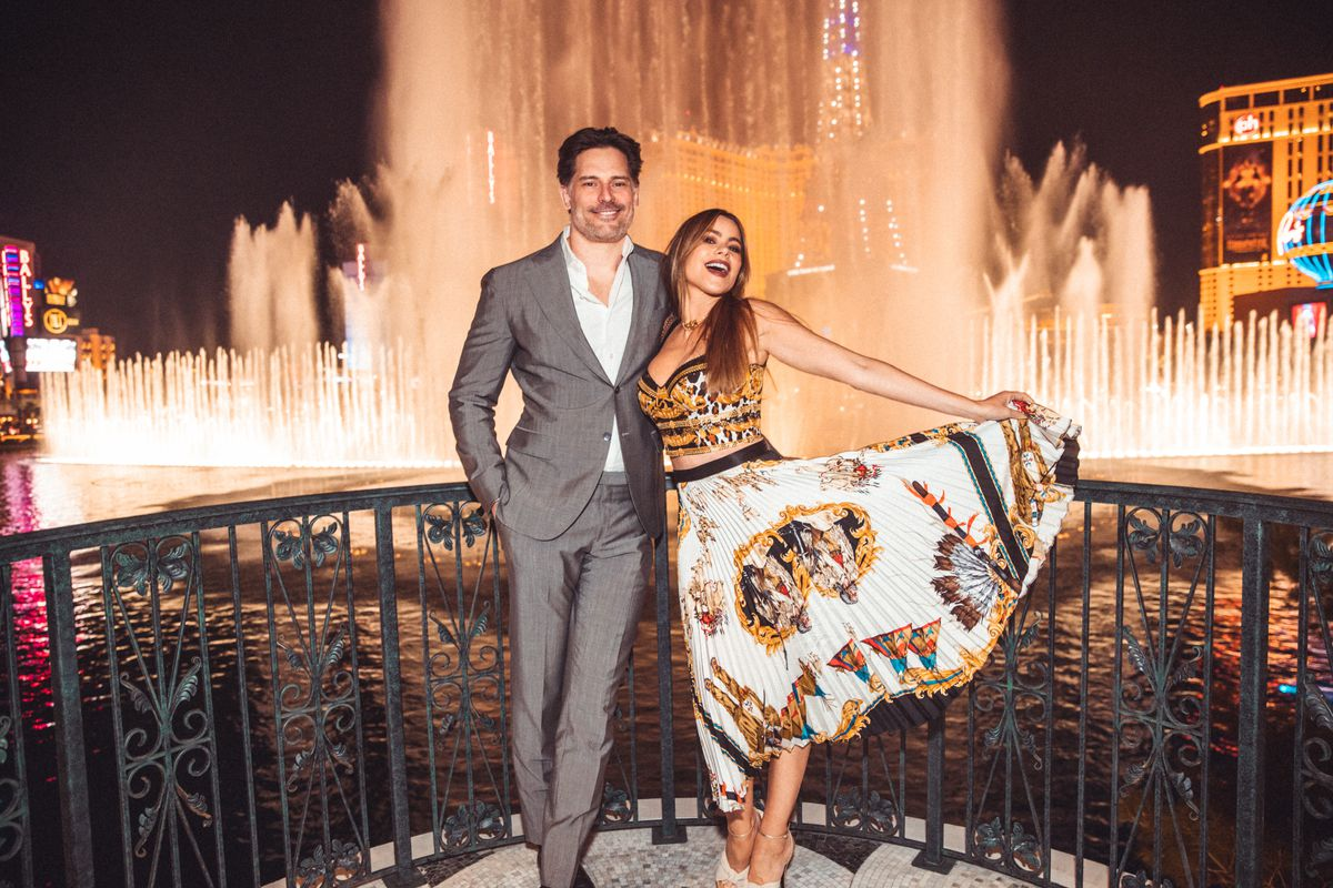 A couple stands in front of fountains