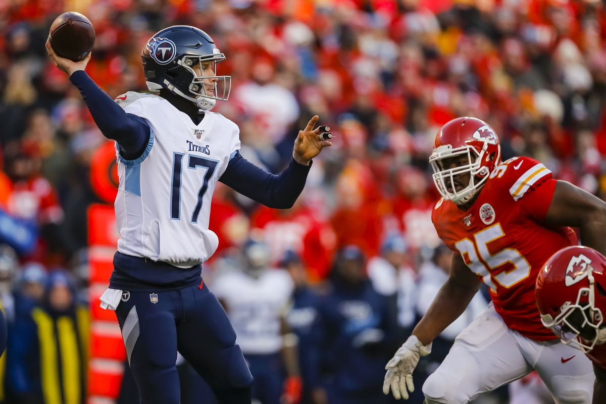 Ryan Tannehill of the Tennessee Titans drops back to pass in the second quarter under pressure from Chris Jones of the Kansas City Chiefs in the AFC Championship game at Arrowhead Stadium on January 19, 2020 in Kansas City, Missouri.