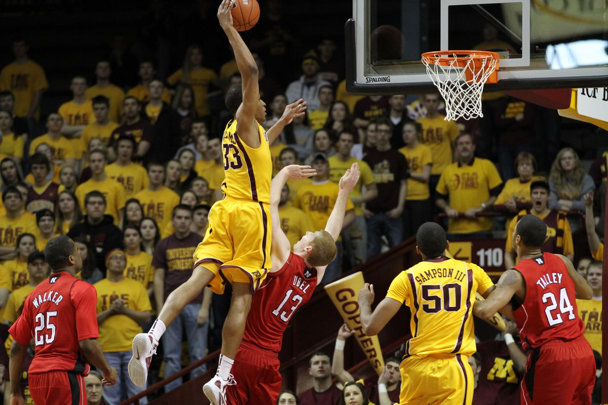 Minnesota Gophers Basketball vs Nebraska, 3/3/12, (left to right) Minnesota Gophers Rodney Williams went to the air and jammed the basket home as he was defended by Nebraska's Brandon Ubel in first half action.] Bruce Bisping/Star Tribune bbisping@star