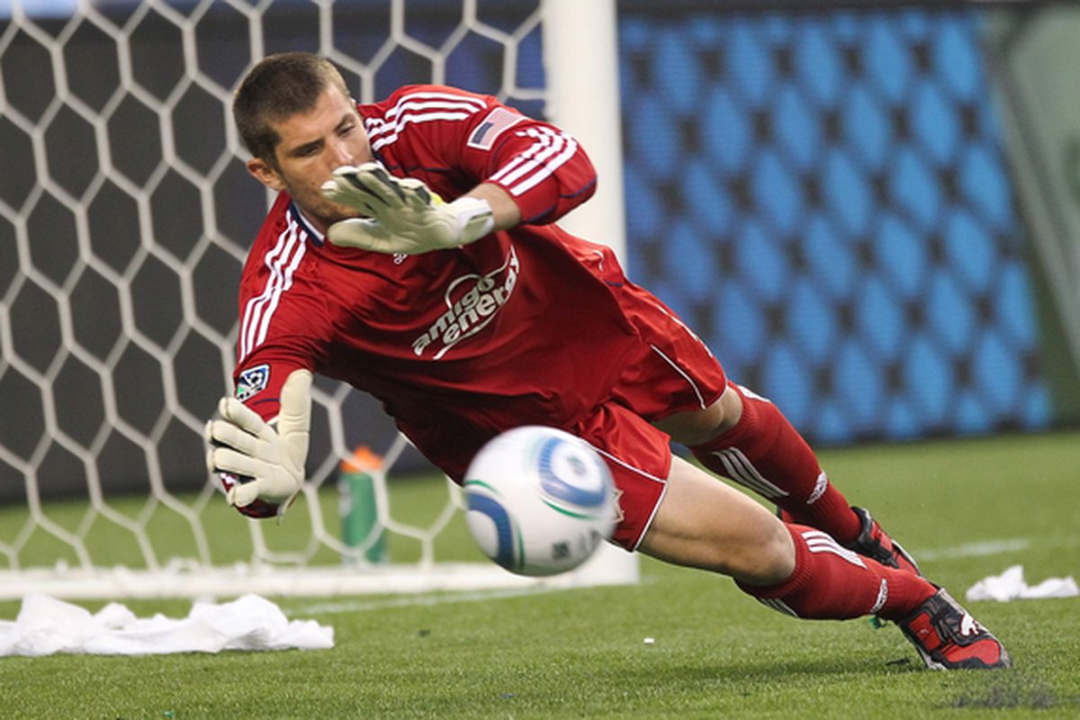 SEATTLE - AUGUST 08:  Goalkeeper Tally Hall #1 of the Houston Dynamo blocks a shot against the Seattle Sounders FC on August 8 2010 at Qwest Field in Seattle Washington. (Photo by Otto Greule Jr/Getty Images)