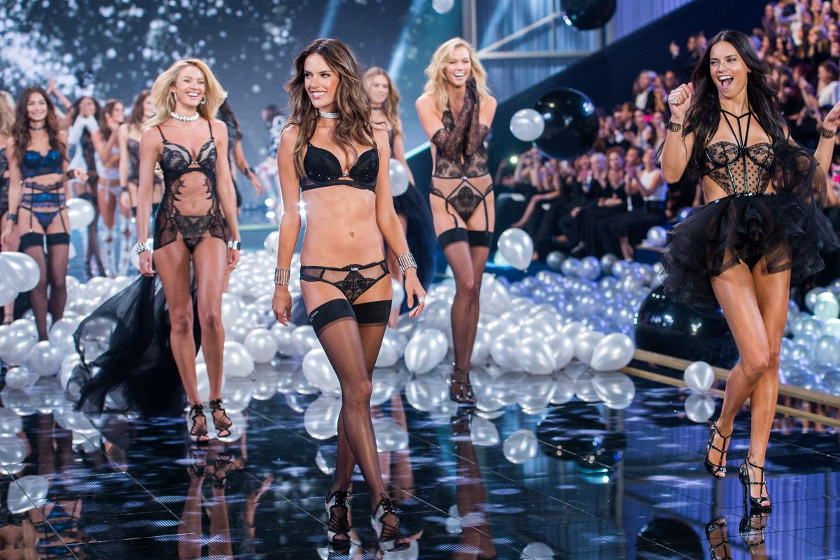 46c459092a Adriana Lima and Alessandra Ambrosio lead models at the 2014 Victoria s  Secret fashion show in London. Samir Hussein Getty Images ...
