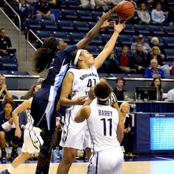 """BYU's Morgan Bailey(41) goes up for an offensive board against San Diego in Provo January 24, 2015.   <img src=""""http://beacon.deseretconnect.com/beacon.gif?cid=245925&pid=7"""" />"""