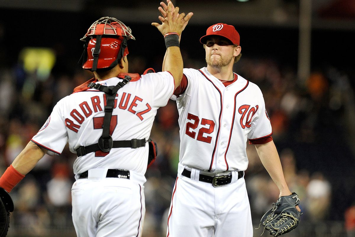 WASHINGTON, DC - APRIL 28:  Drew Storen #22 of the Washington Nationals celebrates with Ivan Rodriguez #7 after a 4-3 victory against the New York Mets at Nationals Park on April 28, 2011 in Washington, DC.  (Photo by Greg Fiume/Getty Images)