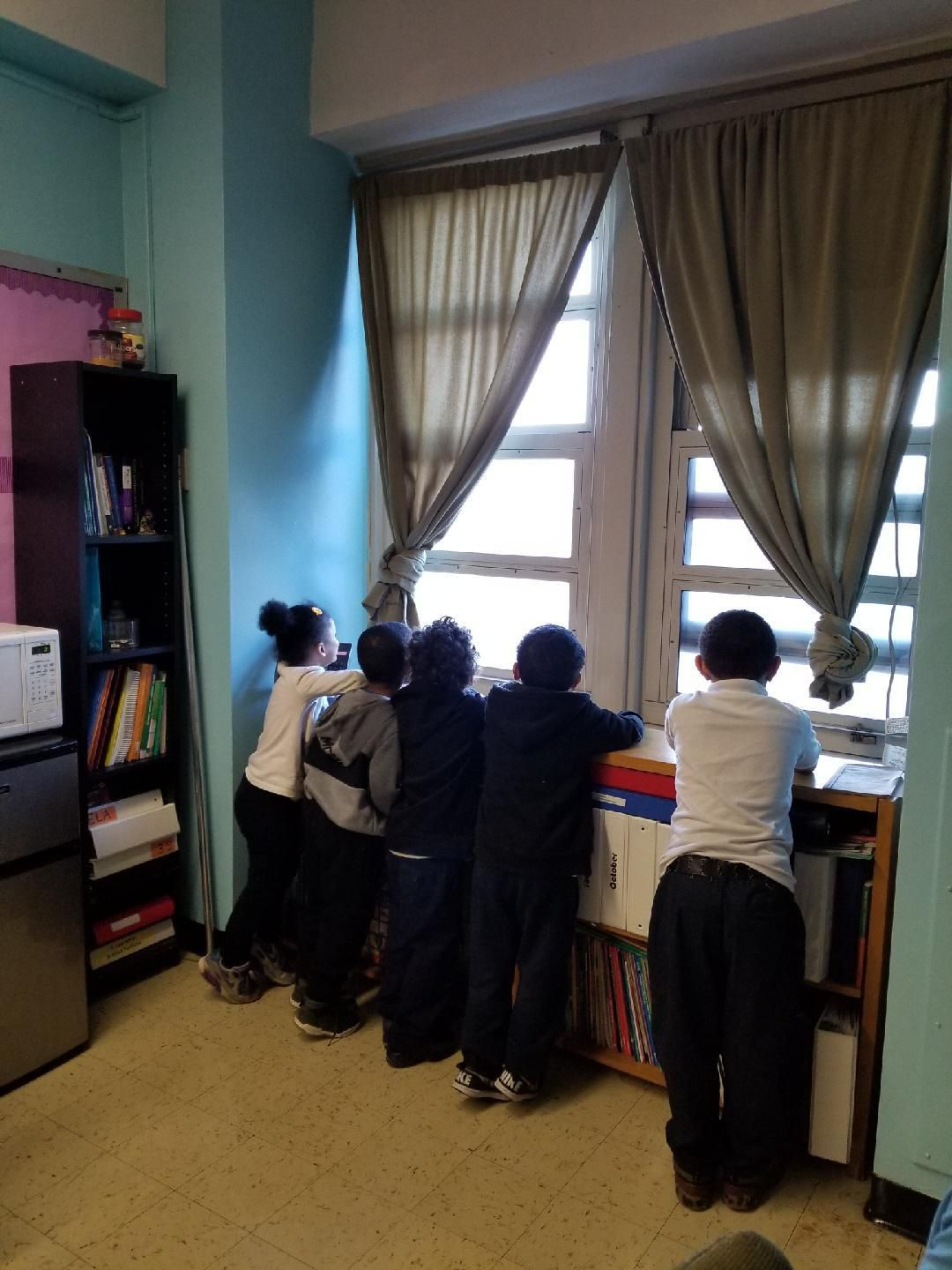 Guggenheim's students gather at the window in her classroom last school year, before the pandemic.
