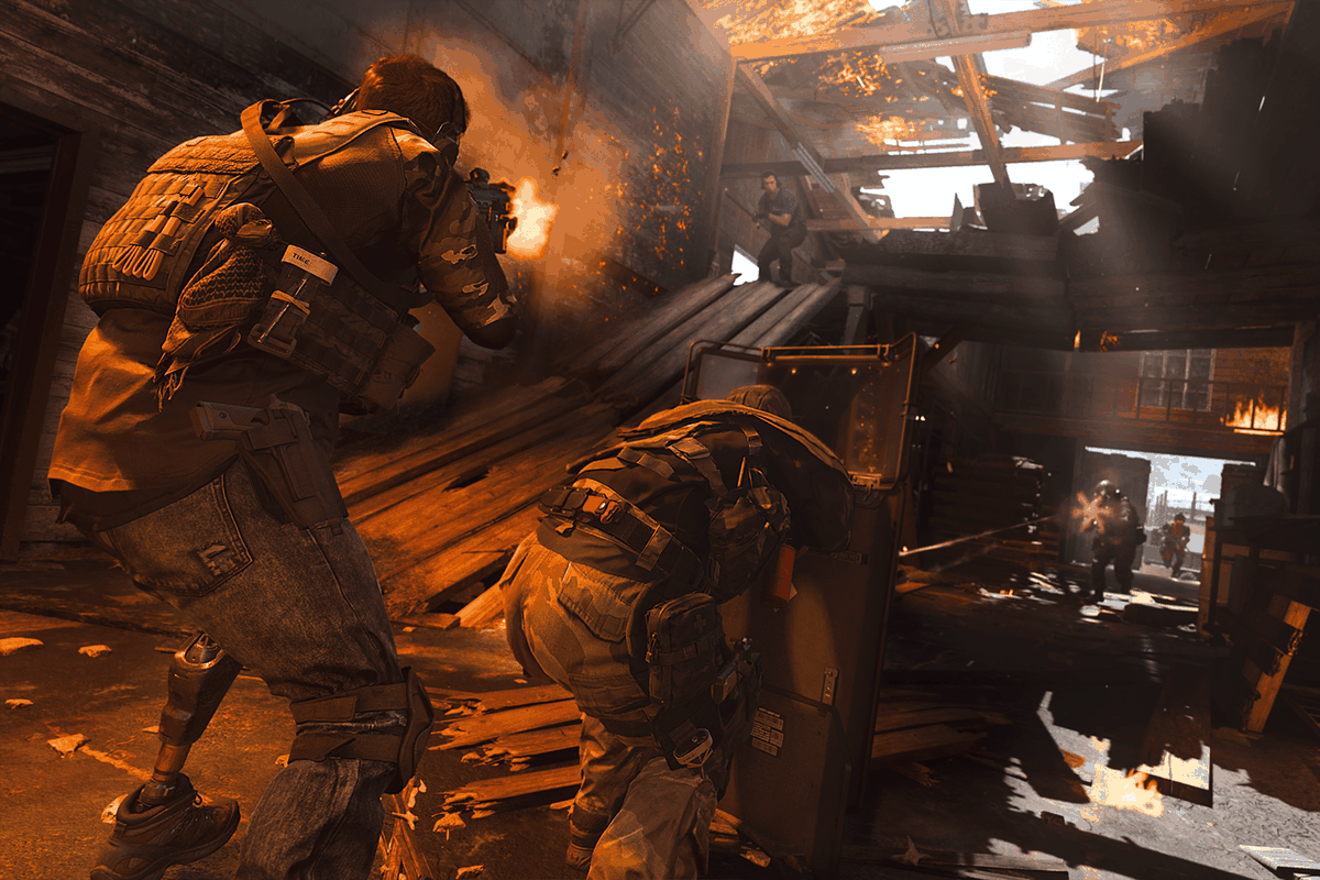 Two Call of Duty: Warzone players face down an enemy in a burning building