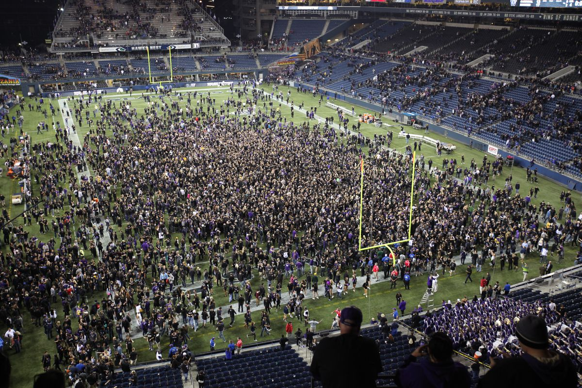 Fans storm the field after Washington beat Stanford in what was probably the high point of the season.