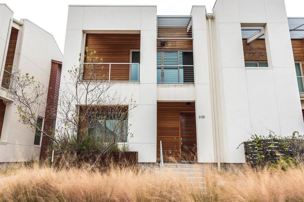 Two-story, white stucco contemporary