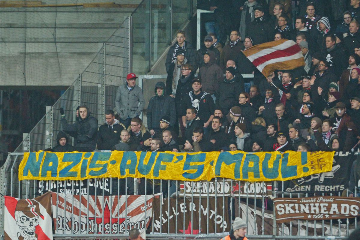 Braunschweig, Germany - Supporters of St. Pauli show a banner against Nazis in the colours of Braunschweig during the Second Bundesliga match between Eintracht Braunschweig and FC St. Pauli at the Eintracht Stadium on November 28, 2012.