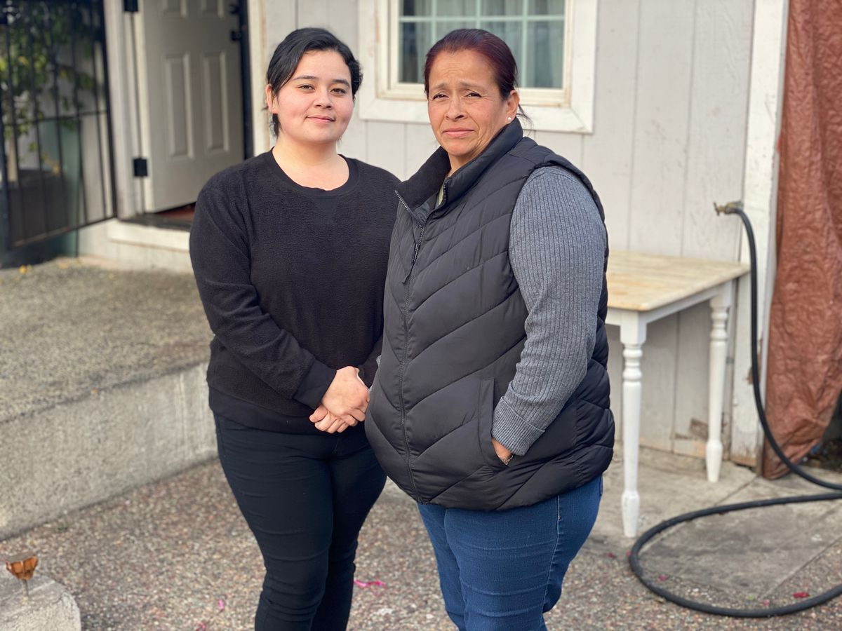 Sandra Martinez (left) and Laura Rivera in front of their home in Richmond