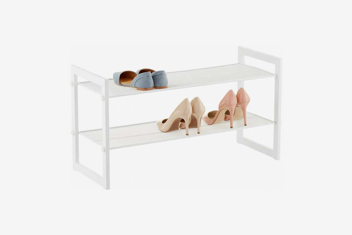 Two-tier white rack for shoes.