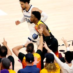 Utah Jazz guard Donovan Mitchell (45) runs past Memphis Grizzlies forward Dillon Brooks (24) after dropping in a 3-pointer over him as the Utah Jazz and the Memphis Grizzlies play in Game 5 of an NBA basketball first-round playoff series at Vivint Arena in Salt Lake City on Wednesday, June 2, 2021.