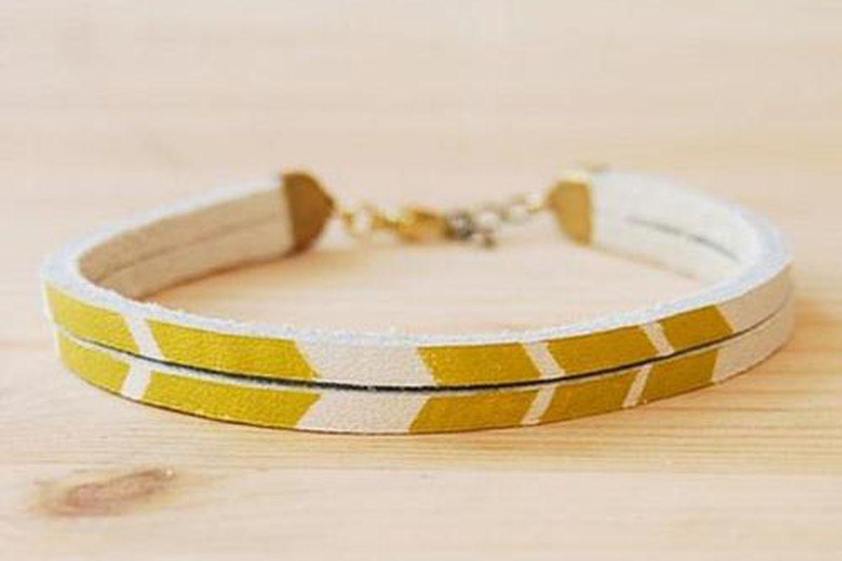 "Mustard Chevron Leather Bracelet, $28 at <a href=""http://www.reppio.com/MilkHandmade/postings/4536"">Milk Handmade</a>/Reppio"