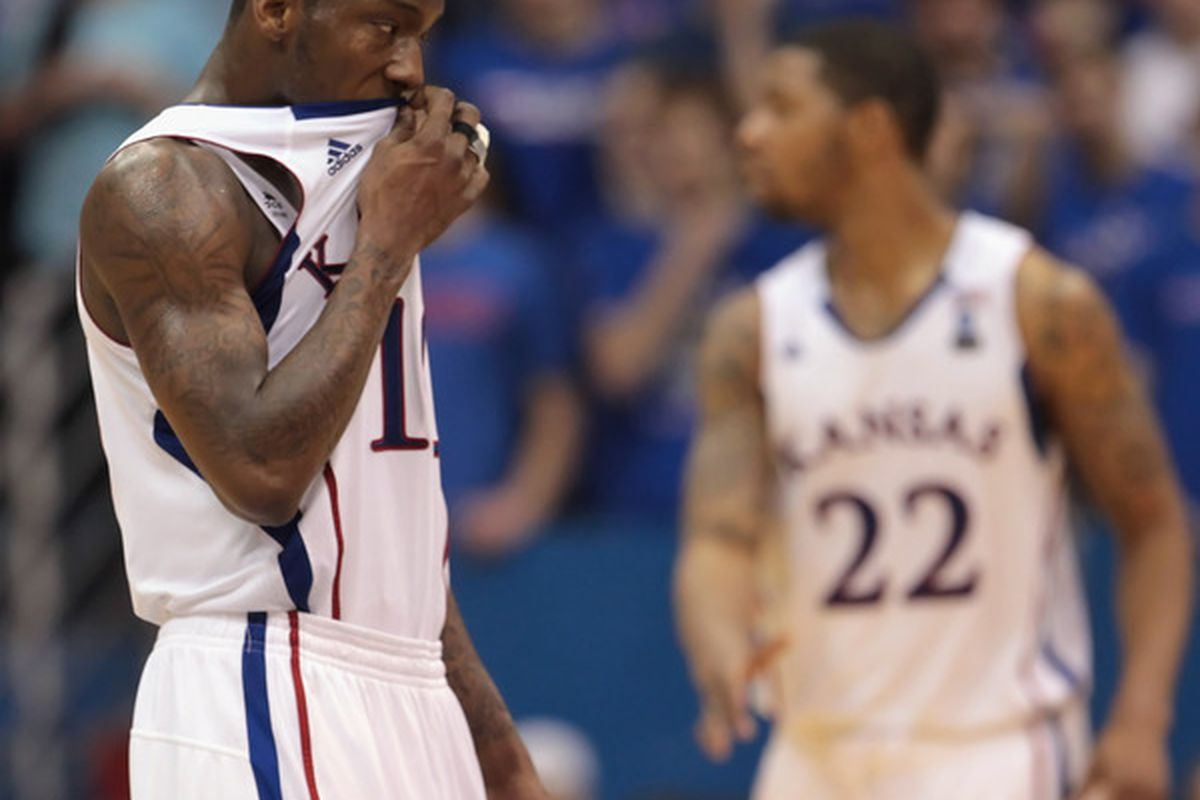 LAWRENCE KS - JANUARY 22:  Tyshawn Taylor #10 of the Kansas Jayhawks racts after a foul during the game against the Texas Longhorns on January 22 2011 at Allen Fieldhouse in Lawrence Kansas.  (Photo by Jamie Squire/Getty Images)