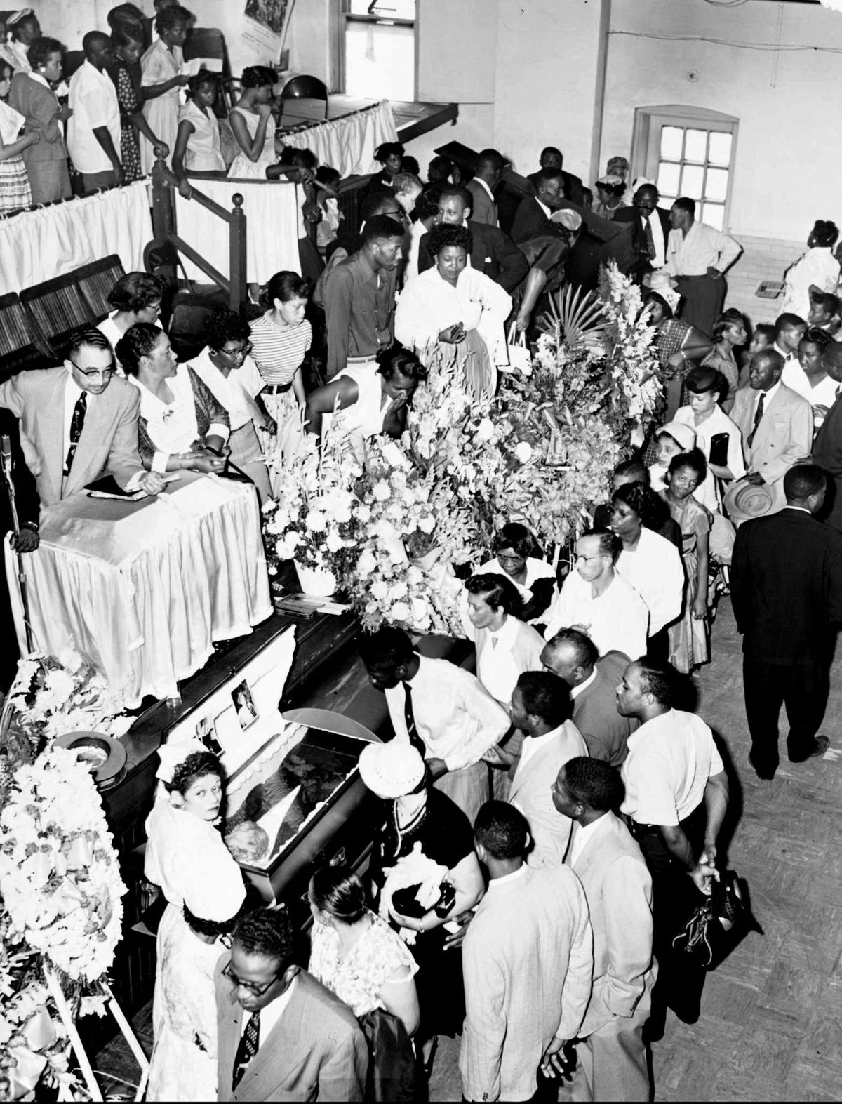 Mourners pass the casket during the funeral Sept. 6, 1955, for 14-year-old Emmett Till at Roberts Temple Church of God in Christ.