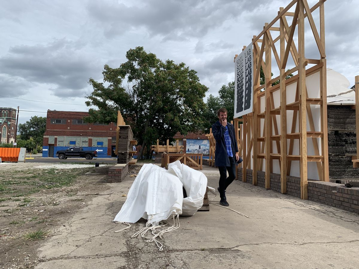 """James Martin, a lead architect for Soil Lab, said he hopes the Soil Lab is always evolving as residents expand their interests and skills. He taught residents how to use an architectural technique called """"rammed earth."""""""
