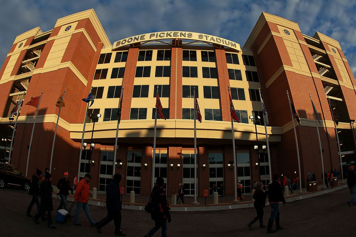 STILLWATER, OK - DECEMBER 03:  Fans walk around the outside of Boone Pickens Stadium before a game between the Oklahoma Sooners and the Oklahoma State Cowboys on December 3, 2011 in Stillwater, Oklahoma.  (Photo by Ronald Martinez/Getty Images)