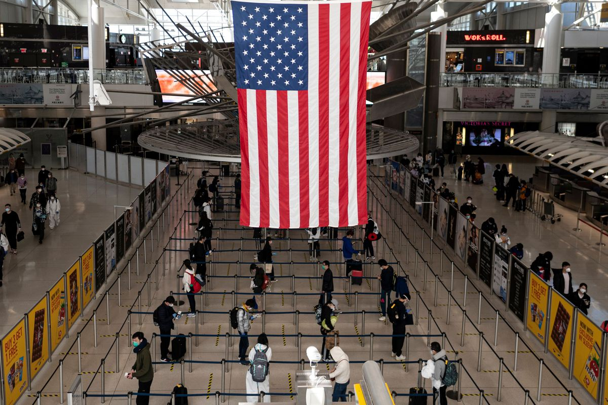 An American flag hangs in an airport.