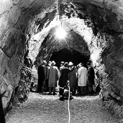 LDS Church officials tour the excavaction for the Granite Mountain Records Vault in Little Cottonwood Canyon in January 1963. The project, which was completed in 1964, protects microfilm records.
