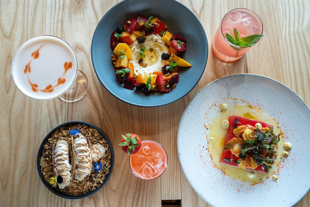 A bird's eye view of an array of colorful dishes and drinks at Sawyer.