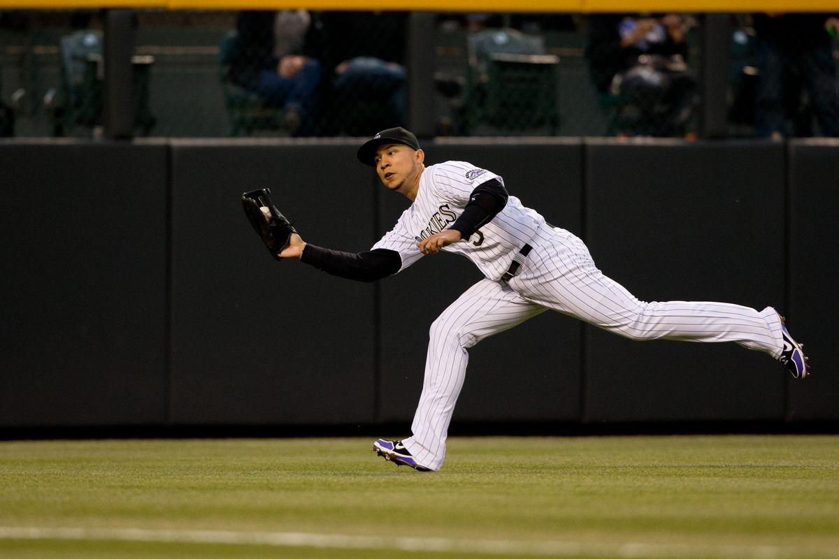 Carlos Gonzalez makes a catch during last night's 3-1 win over the Arizona Diamondbacks.