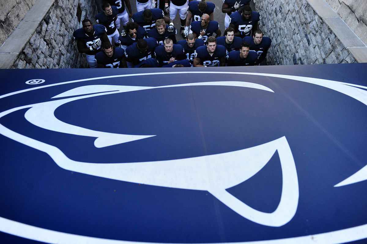STATE COLLEGE, PA - NOVEMBER 12: Penn State players sing the pledge of allegiance before taking on Nebraska at Beaver Stadium on November 12, 2011 in State College, Pennsylvania. (Photo by Patrick Smith/Getty Images)