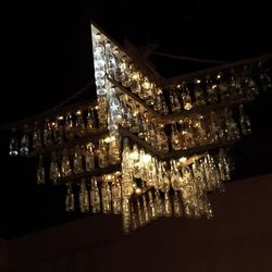 This chandelier is made from Zima bottles.
