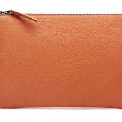 Exclusive orange clutch, $150.