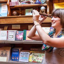 Store Manager Caroline Kangas surveys the store through the spy glass.