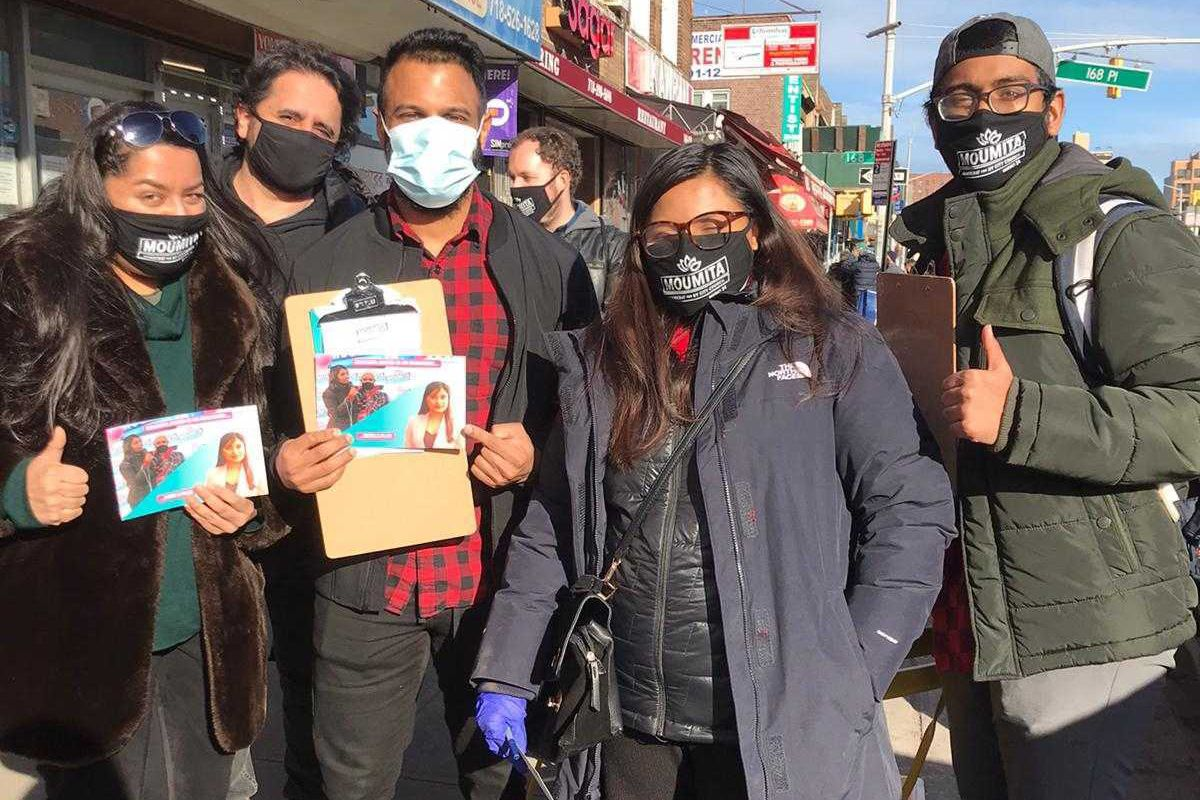 Volunteers gather signatures for Moumita Ahmed's Queens City Council run.