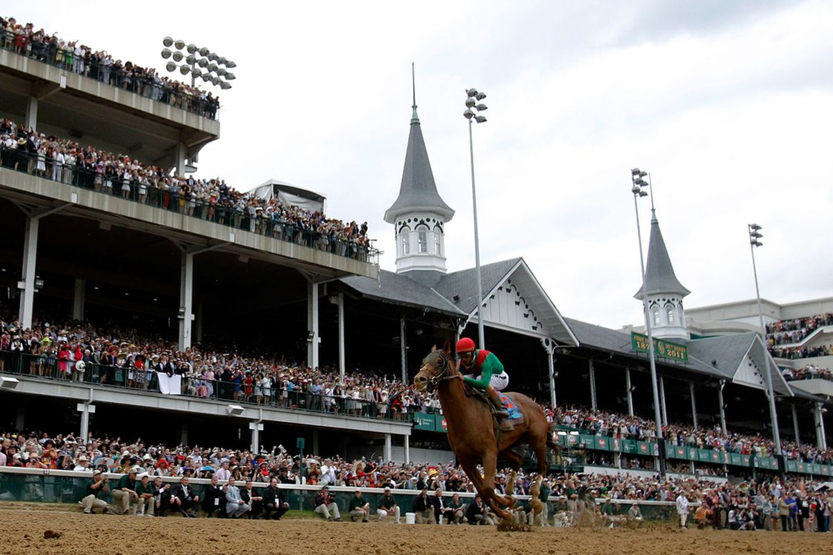 LOUISVILLE, KY - MAY 07:  Jockey John Velazquez, riding Animal Kingdom #16 crosses the finish line on way to winning the 137th Kentucky Derby at Churchill Downs on May 7, 2011 in Louisville, Kentucky.  (Photo by Rob Carr/Getty Images)