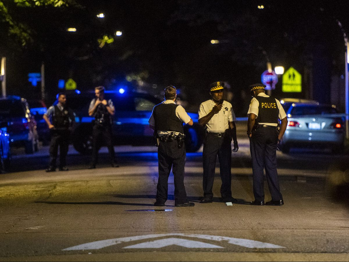 Police investigate a shooting Monday night in the 6400 block of South May that left five people wounded | Tyler LaRiviere/Sun-Times