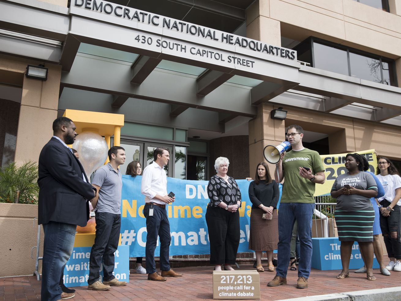 Jack Shapiro speaks in front of the Democratic National Committee headquarters, during a Greenpeace rally to call for a presidential campaign climate debate on June 12, 2019, in Washington, DC.