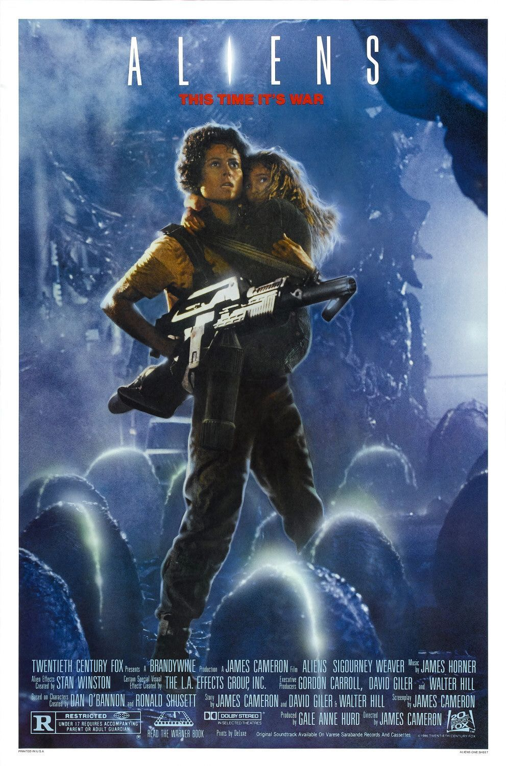 The poster from Aliens, with Sigourney Weaver holding a little girl as well as a huge gun.