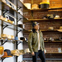 <b>Erwin Samson</b>, US and International Sales Manager, wearing a Twill Glacier Shirt from Fair Ends, henley from Gap, black chinos from Urban Outfitters, Stance Socks, black Vans, and a Goorin Bros. baseball hat.<br> <b>Your closet is on fire! What thr