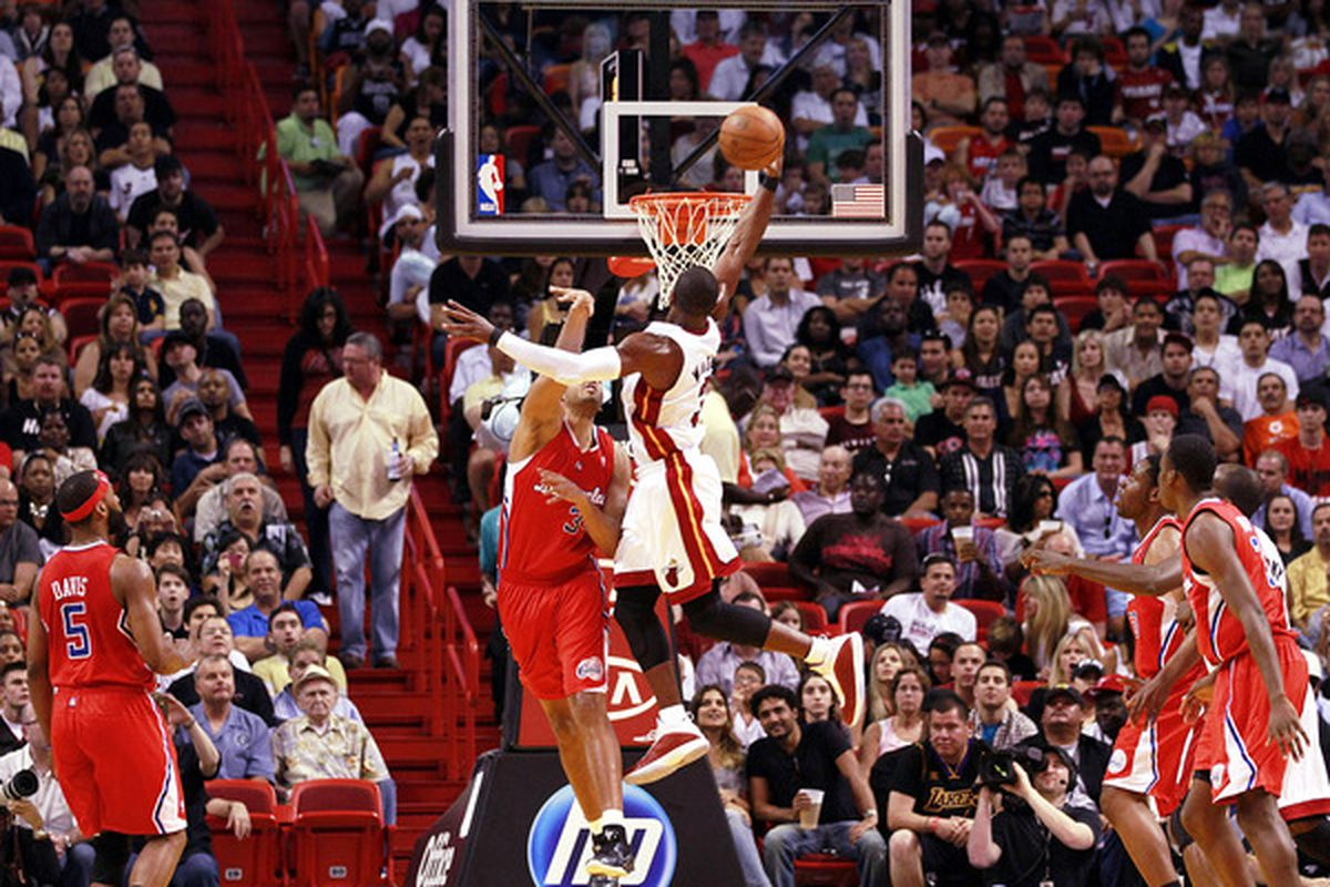 MIAMI - FEBRUARY 06:  Guard Dwyane Wade #3 of the Miami Heat dunks against the L.A. Clippers at American Airlines Arena on February 6 2011 in Miami Florida. (Photo by Marc Serota/Getty Images)