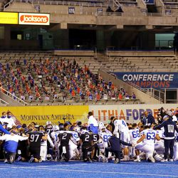 Both BYU and Boise State gather at midfield for a prayer following the game at Albertsons Stadium in Boise on Friday, Nov. 6, 2020. BYU won 51-17.
