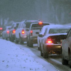 Commuters drive near the University of Utah in a snow storm Thursday, Jan. 10, 2013. Up to 300 vehicles were stuck overnight Saturday on the Arizona Strip, a 30-mile stretch of I-15 between Utah and Nevada in northwestern Arizona because of an unusual snowstorm.