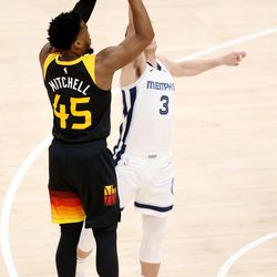 Utah Jazz guard Donovan Mitchell (45) drops in a 3-point shot over Memphis Grizzlies guard Grayson Allen (3) as the Utah Jazz and Memphis Grizzlies play Game 2 of their NBA playoffs first round series at Vivint Arena in Salt Lake City on Wednesday, May 26, 2021.