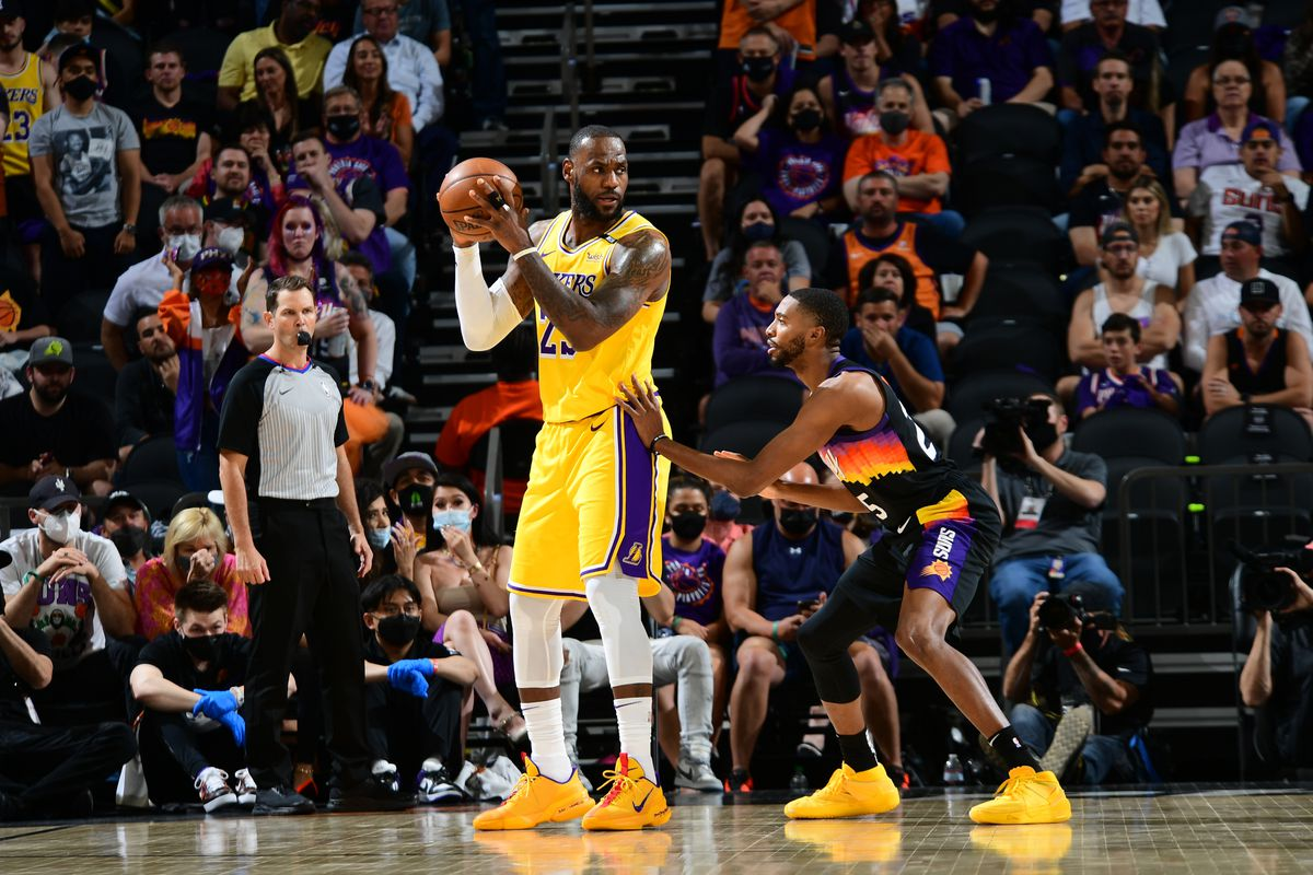 LeBron James #23 of the Los Angeles Lakers handles the ball against the Phoenix Suns during Round 1, Game 2 of the 2021 NBA Playoffs on May 25, 2021 at Phoenix Suns Arena in Phoenix, Arizona.