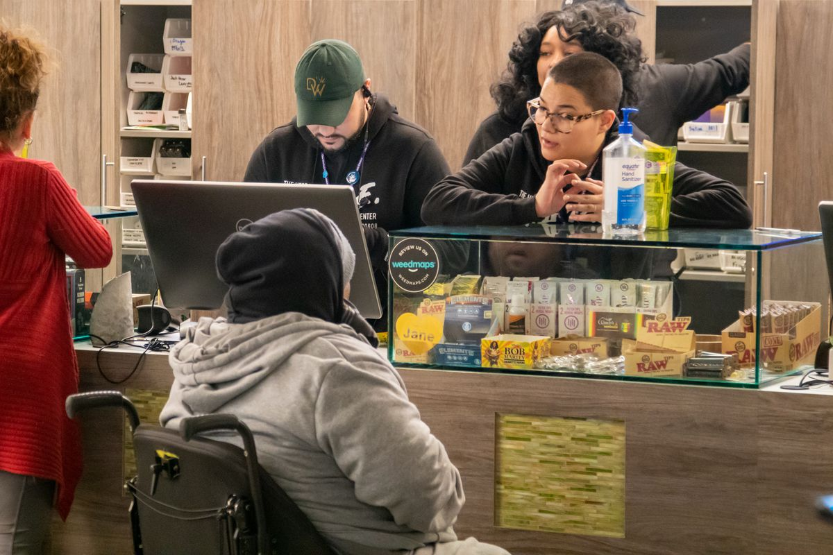 Workers at The Herbal Care Center dispensary at 1301 South Western Avenue help a customer this week.