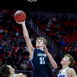 Layton's Ethan Potter drives between Fremont's Baylor Harrop and Kipp Calder in a 6A boys basketball semifinal game at the Huntsman Center in Salt Lake City on Friday, Feb. 28, 2020.