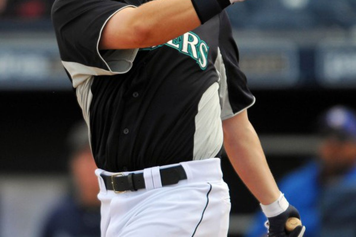 Mar 19, 2012; Peoria, AZ, USA;  Seattle Mariners first baseman Justin Smoak (17) at bat during the seventh inning against the Chicago Cubs at Peoria Stadium. Mandatory Credit: Christopher Hanewinckel-US PRESSWIRE