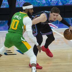 Utah Jazz guard Mike Conley, left, guards Sacramento Kings guard Kyle Guy, right, during the first quarter of an NBA basketball game in Sacramento, Calif., Sunday, May 16, 2021.