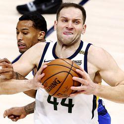 Utah Jazz forward Bojan Bogdanovic (44) spins away from Dallas Mavericks guard Trey Burke (3) as the Utah Jazz and the Dallas Mavericks play an NBA basketball gameat Vivint Smart Home Arena in Salt Lake City on Wednesday, Jan. 27, 2021. Jazz won 116-104.