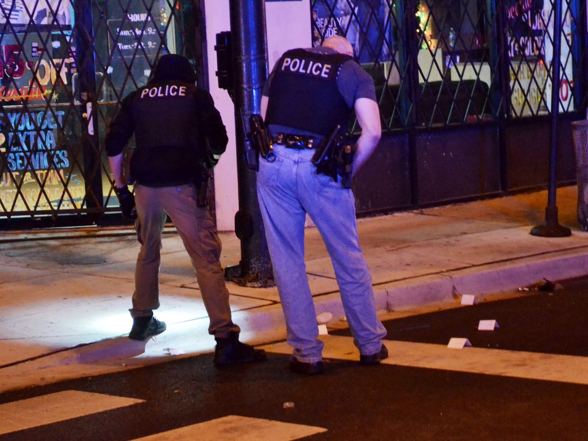 Police investigate a shooting early Saturday in the 100 block of East 51st Street. | Justin Jackson/Sun-Times
